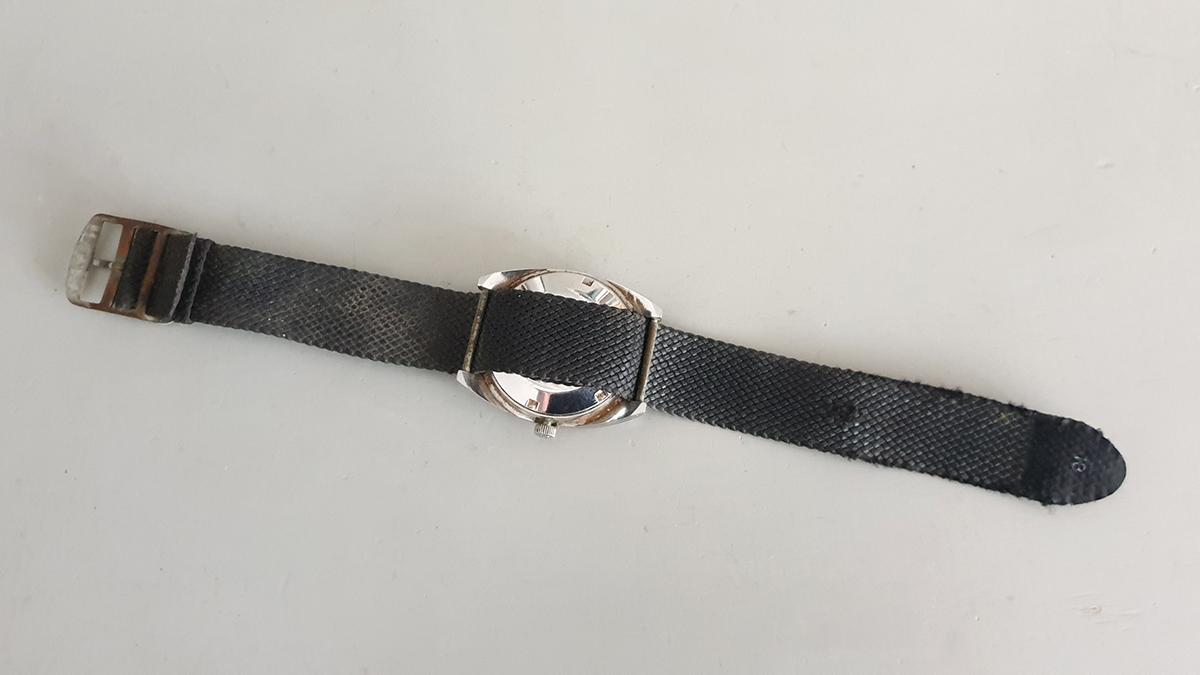 Sandoz horloge onderkant